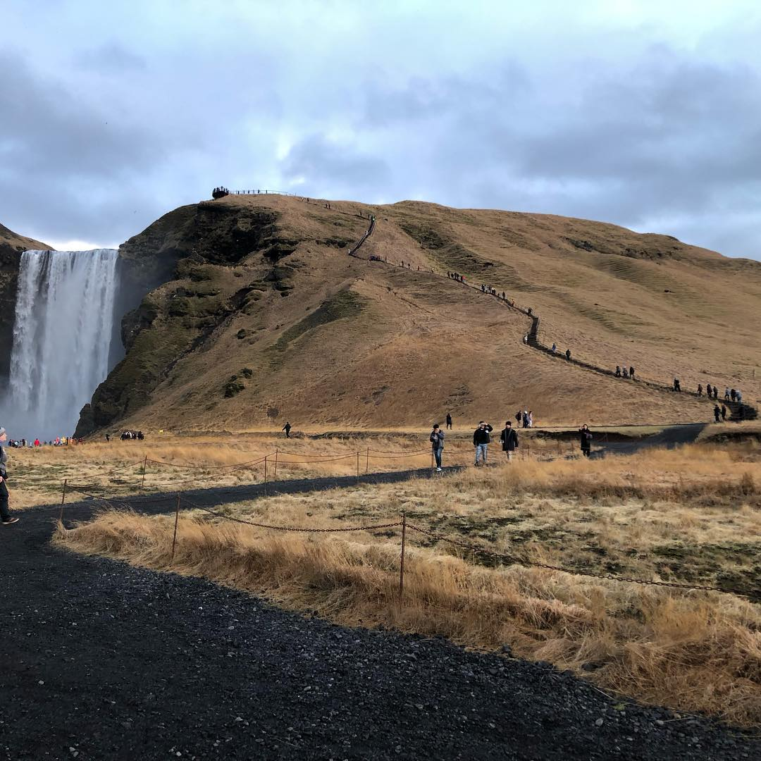 hiking up skogafoss